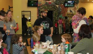 Mike, Nicole, and Eisley (centered) at an Intact Michigan meetup.